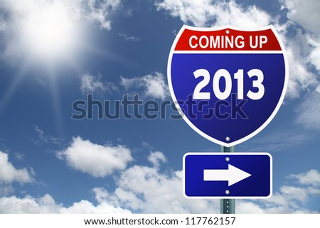 Coming up 2013 interstate red and blue road sign against of beautiful sky