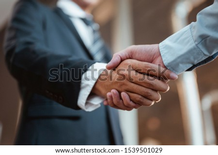 Commander handshaking new employee congratulating with starting a new job. Teamwork collaboration concept for business partners, Meetings and greetings concepts.