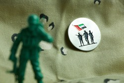 Commemoration Day badge - army toy in front of Commemoration Day badge