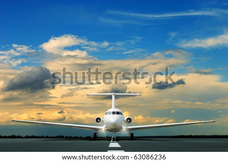 Commercial airliner on runway at dusk