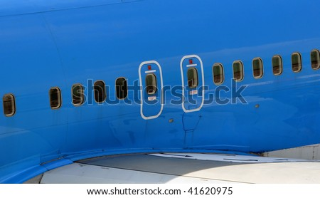 Commercial airliner: view of the overwing emergency exits. - stock photo