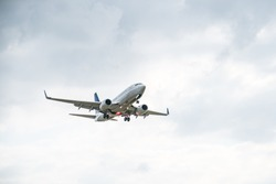 Commercial airplane on sky - passenger aircraft isolated