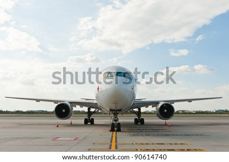 Commercial airplane parking at the airport