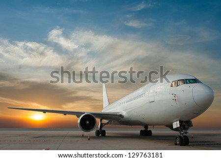 Commercial airplane with sunset stock photo