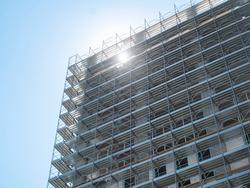Commercial building under construction, modern skyscraper under development, new construction