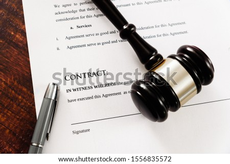 Commercial contracts must be signed, simulated contract seen from above.