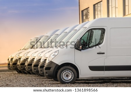 commercial delivery vans parked in row. Transporting service company. #1361898566