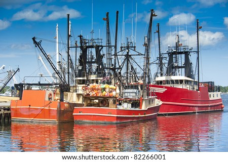 Commercial fishing boats in New Bedford harbor, Massachusetts, USA - stock photo