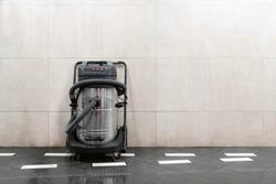 Commercial hoover next to the wall at car wash. Copy space for text. Commercial vacuum cleaner, self service.