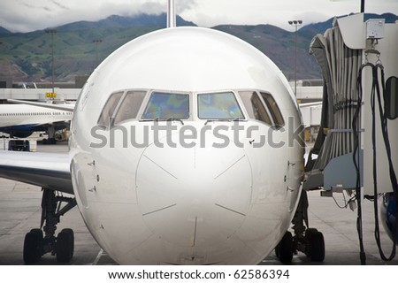 Commercial jet airplane parked at loading gate