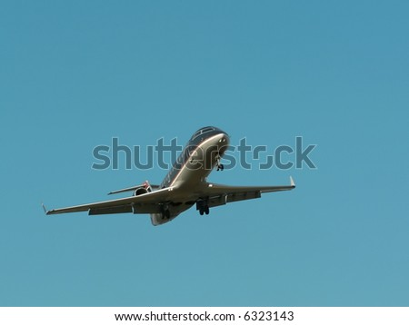 commercial jet in flight with a bright blue sky in the background. copy space included