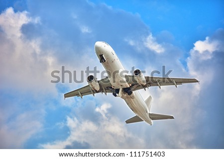 Commercial jet plane - flight in cloudy sky. White passenger airplane.