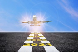Commercial plane ready for landing or taking off with year 2021 to 2024 written on runway background. Airplane business recovery after covid-19 impact to airplane transport industry crisis concept