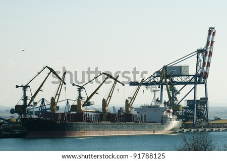 Commercial port cranes. Cranes in a port