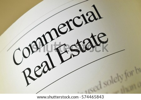 Commercial real estate: newspaper headlines with text background #574465843