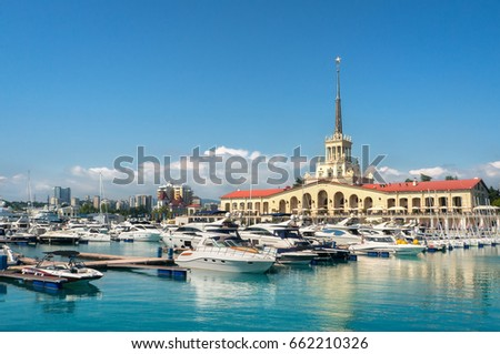 Commercial seaport of Sochi, Russia. Yachts and ships on Black Sea. #662210326