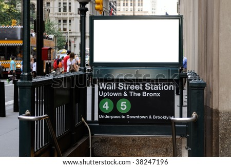 Commercial sign in Wall Street subway station. Blank billboard with crowd and traffic in the background. Manhattan Financial District, New York City.