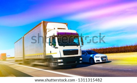Commercial transport .  truck transport container . Commercial transport .  truck transport container   . transportation of freight Europe . industrial infrastructure . #1311315482