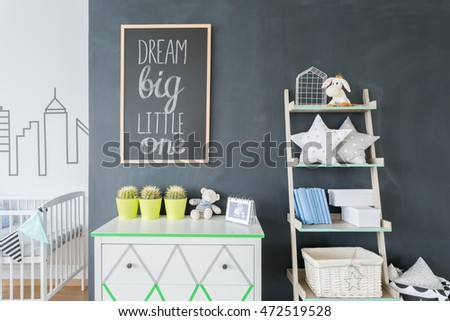 Commode and minimalistic rack with pillows at the black wall background #472519528
