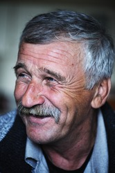 Common elderly positive man with mustache, happy smiling