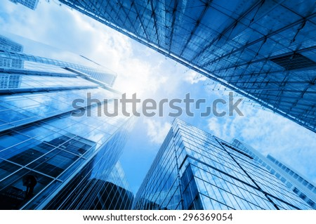 Common modern business skyscrapers, high-rise buildings, architecture raising to the sky, sun. Concepts of financial, economics, future etc. #296369054
