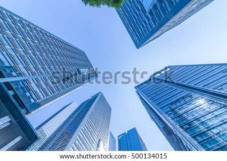 Common modern business skyscrapers, high-rise buildings, architecture raising to the sky, sun. Concepts of financial, economics, future etc. #500134015
