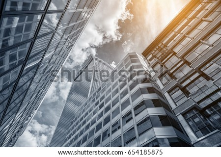 Common modern business skyscrapers, high-rise buildings, architecture raising to the sky, sun #654185875