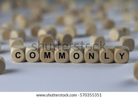 commonly - cube with letters, sign with wooden cubes Сток-фото ©