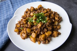 Commonly referred to as 'chai tow kway' in the Teochew dialect, these smooth and soft fried rice cakes. They are also know as fried carrot cake. Black version where black sweet sauce is used
