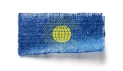 Commonwealth flag on a piece of cloth on a white background