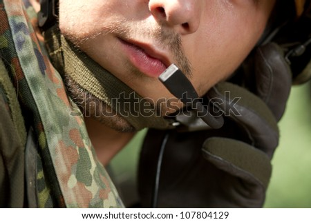 Communicating with the base to get new orders - stock photo