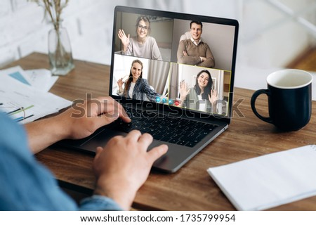 Communication by video conference. Close up photo of laptop screen with people. Business colleagues discuss about economic trends by video conference from home. Distant work
