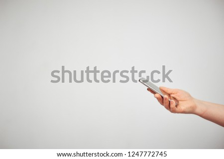 communication, communication, communication. female hand holding smartphone on white background