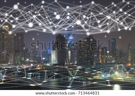 Communication network of Scene of Hong Kong Cityscape river side at night time, Technology Smart City with Internet of Things concept #713464831