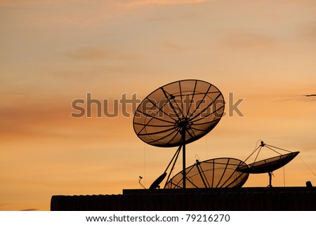 Communication Satellite against beautiful sky at sunset,silhouette style