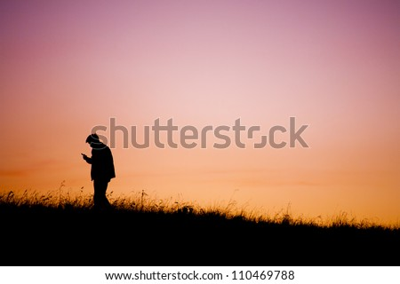 Communication - silhouette of man handle phone