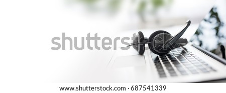 Communication support, call center and customer service help desk. VOIP headset on laptop computer keyboard. - Shutterstock ID 687541339