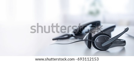 Communication support, call center and customer service help desk. VOIP headset on laptop computer keyboard. - Shutterstock ID 693112153