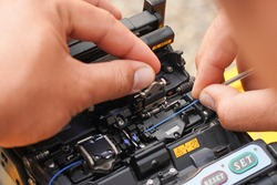 Communication system technician checks the data line connection Cable technology Fiber Optic Fusion Splicing Internet Signal and Cabling with Fiber Optic Fusion Splicing Machine Fiber Optic Splicing M