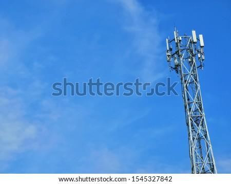 Communication telecom tower,5G Network for customer.Blue sky background,