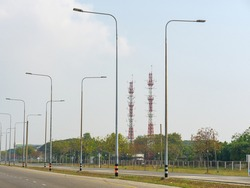 communication transmission towers by street view over sunny blue sky the digital telecom and  intranet network signal transmitter and receiver tower for aviation technology