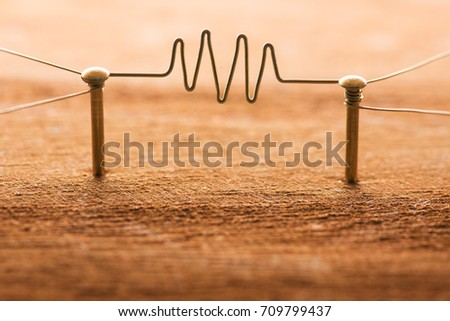 Communication. Two entities or network being connected with gold wire with wave form or in middle. Communication, Networking, social media, internet communication abstract. Rustic wood background.