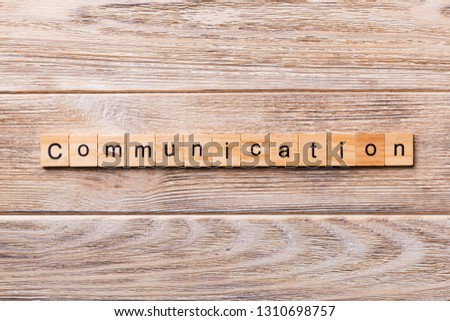 COMMUNICATION word written on wood block. COMMUNICATION text on wooden table for your desing, concept.