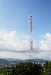 Communications Tower with a Blue Sky Background. Radio tower with antennas on a blue sky background.