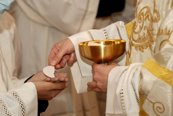 Communion rite during mass in a Catholic church