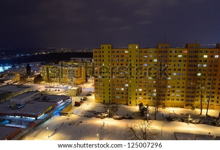 Communist residential blocks and houses at night. - stock photo
