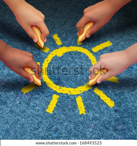 Community education and children learning and development concept with a group of hands representing ethnic groups of young people holding chalk cooperating together as friends to draw a yellow sun.