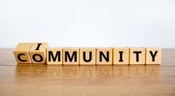Community immunity symbol. Turned cubes and changed the word 'community' to 'immunity'. Beautiful white background, copy space. Business, medical and community immunity covid-19 concept.