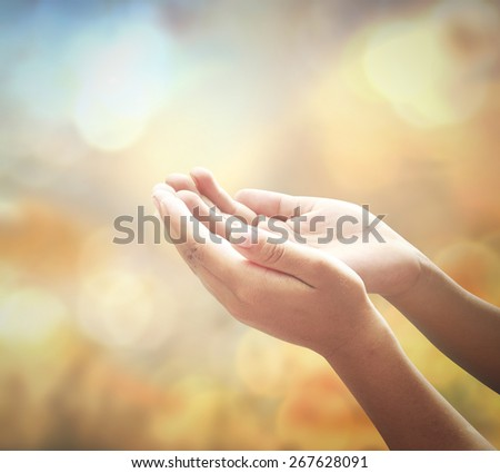Community meditation concept: Christian reaching hands for praying to God over blurred nature background. #267628091