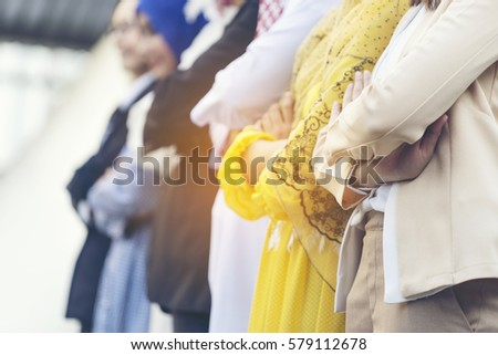 Community of Multiethic businessman and business woman making arms crossed during a meeting in order to show to everyone that they are providing collaboration and trust each other, muslims, arab